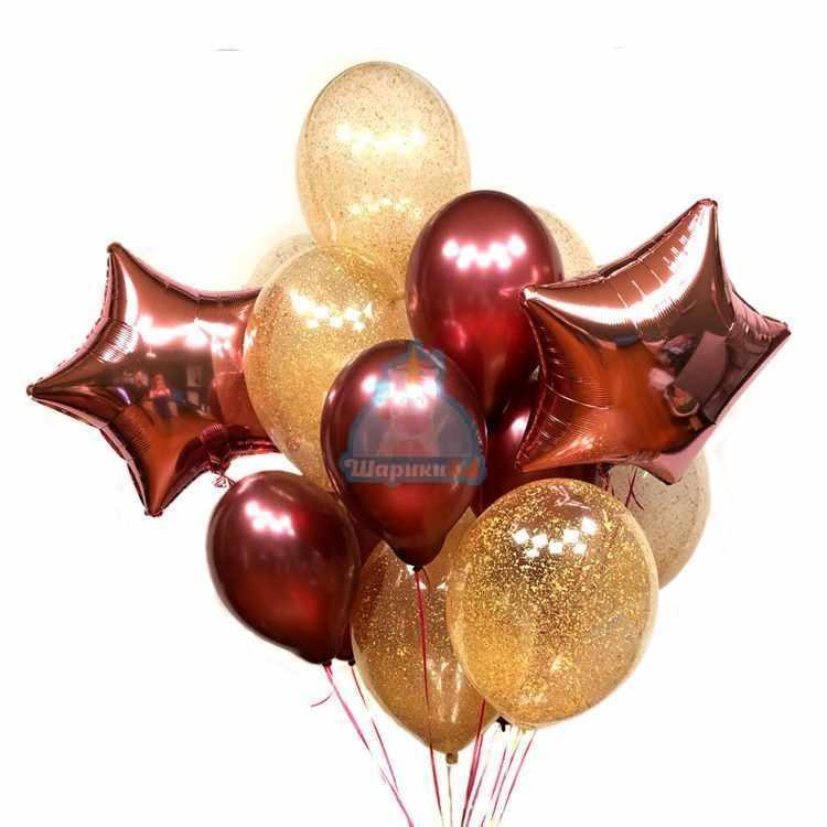 Композиция из бордовых и прозрачных шаров с золотыми блестками и звездами