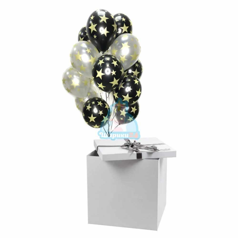 Облако черных и серебряных шариков с рисунком золотых звезд в коробке