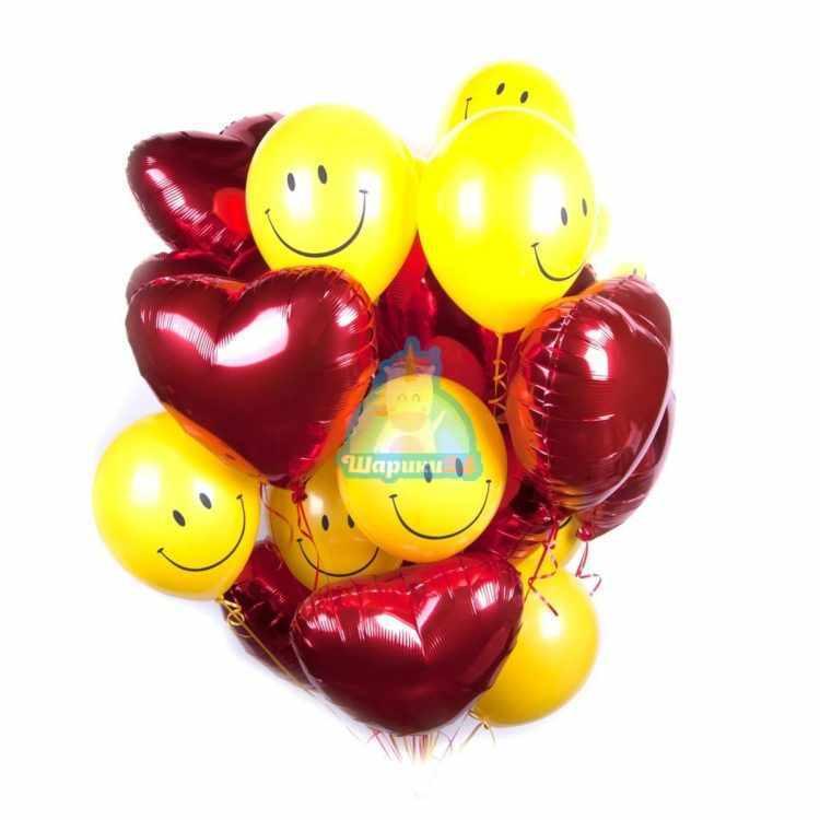 Композиция из гелиевых шаров красных сердец со смайлами на 8 марта