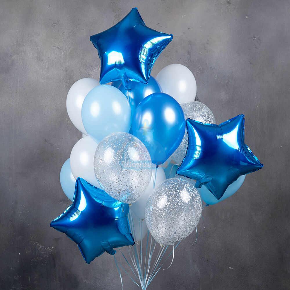 Композиция бело-синих шаров со звездами и прозрачными шарами с серебряными блестками