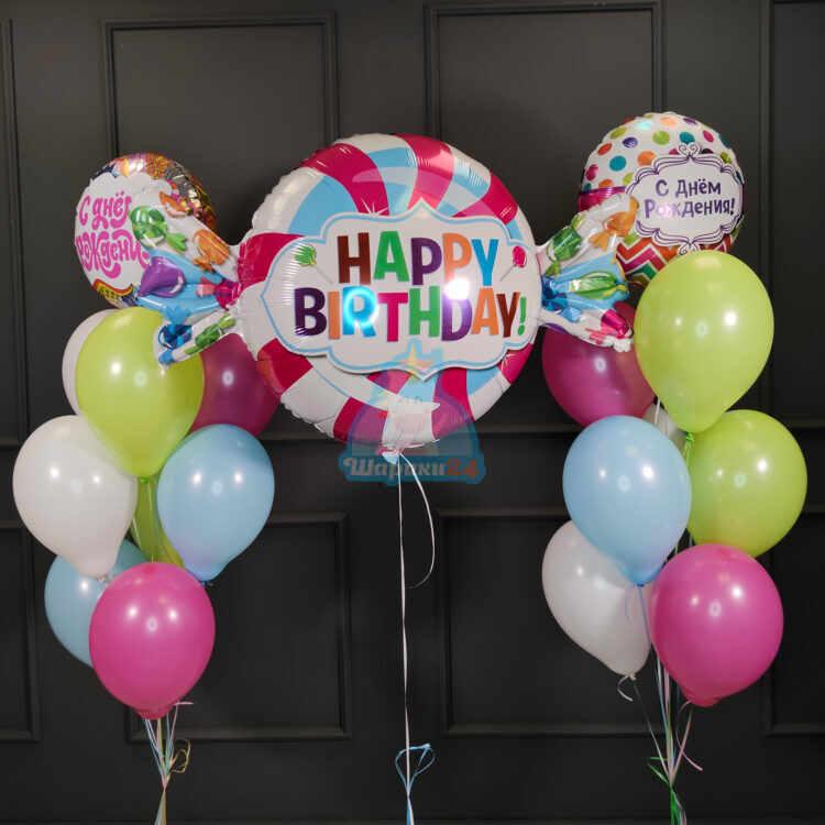 Композиция из воздушных шаров с фольгированными кругами и конфетой