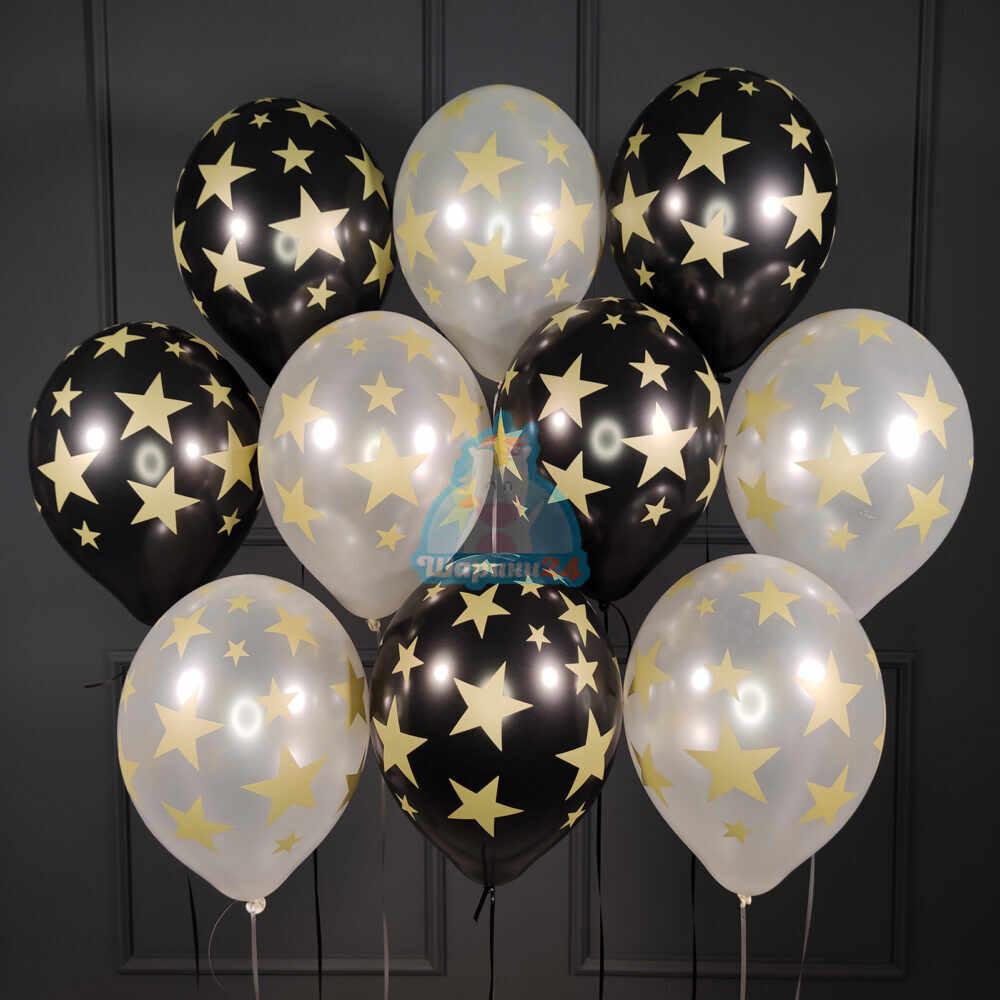 Облако черных и серебряных шариков с золотыми звездами