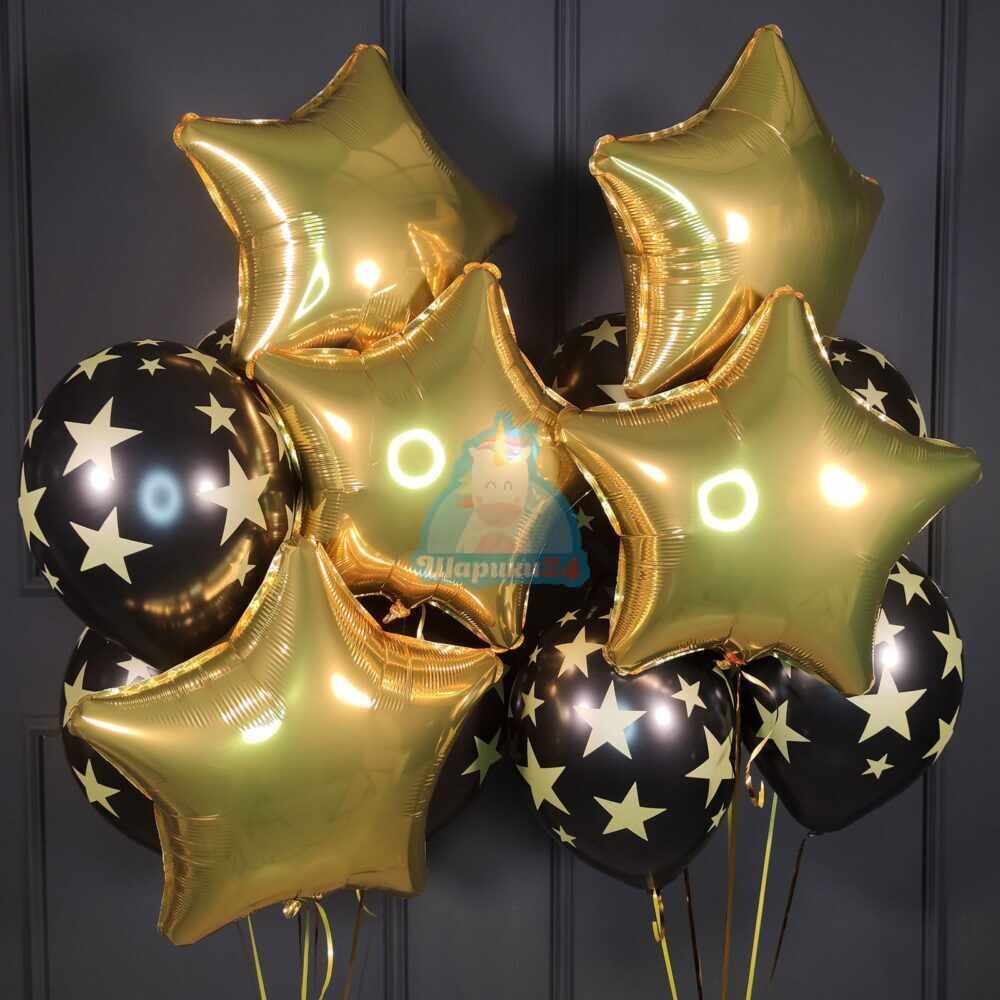 Композиция с золотыми звездами и черными шарами со звездами на новый год