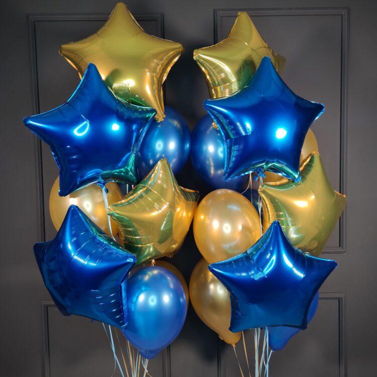 Композиция из золотых и синих звезд и шаров