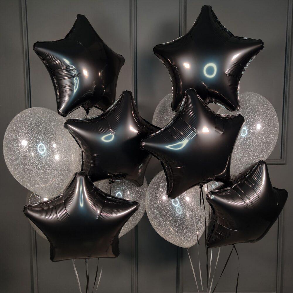 Композиция из прозрачных шаров с блестками и черными звездами